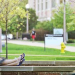 girl reading on campus