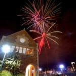 fireworks over buildings on campus